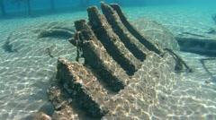 Old wrecked wooden fishing boat on the sandy bottom, Red sea, Marsa Alam, Egypt Stock Footage