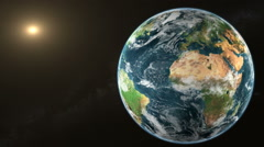 Planet Earth rotate in space with Sun - stock footage