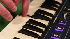Young hands of man playing synthesizer Stock Footage