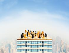 Chess figures on the building - stock photo