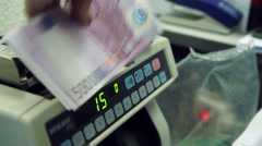 Counting 100 euro banknotes on currency counter machine. Close-up shot. Stock Footage