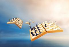 Chess boards in the air - stock photo