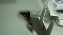 Stock Video Footage of Counting 100 euro banknotes on currency counter machine. Close-up shot.