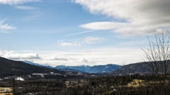 Moving cloudscape over mountain region town Stock Footage