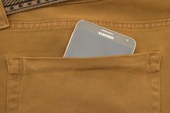 Stock Photo of Modern SAMSUNG GALAXY NOTE in a denim pocket