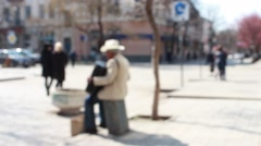 Old man plays an accordion - stock footage