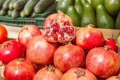 Pomegranate Healthy Fruit on the marketplace at daylight. - stock photo