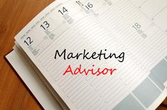 Marketing advisor write on notebook - stock photo