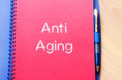 Anti aging write on notebook Stock Photos