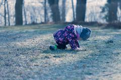 Little baby toddler fall down during exploring outside world Kuvituskuvat