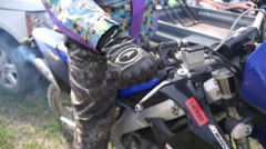 the rider turns the gas handle - stock footage