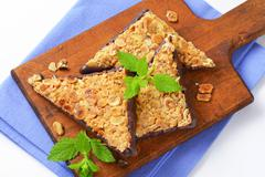 Chocolate-dipped nut triangles (Nussecken) - German sweet Kuvituskuvat