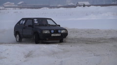 Race car turn snowdrift Stock Footage