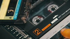 Pushing a Finger Play and Stop Button on a Two Decks Tape Recorder Stock Footage