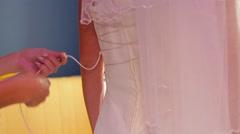 Tightening corset bride Stock Footage