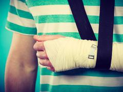 Part body man with bandaged hand. Stock Photos