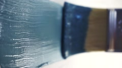 Paint brush in blue wall - stock footage