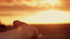 human hand in the sunset - stock footage