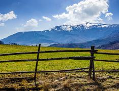 Rural area with snowy mountain tops Stock Photos