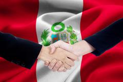 Agreement handshake with flag of Peru - stock photo
