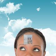 Composite image of close up of woman looking upwards diagonally  Stock Photos