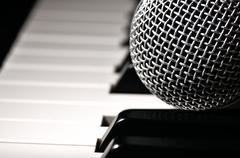 Microphone on a piano keyboard. Stock Photos