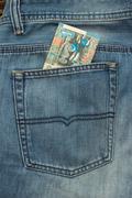 Banknote in back pocket - stock photo
