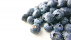 Closeup of Blueberries Rotating on White Background - stock footage