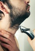 man trimming beard hair closeup - stock photo