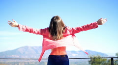 Woman with wide open arms enjoying sunny day on terrace, super slow motion 240fp Stock Footage