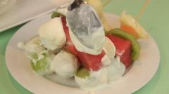 Serving Fruit Kebabs With Yogurt Stock Footage