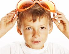 Little cute boy in orange sunglasses pointing isolated close up part of face Stock Photos