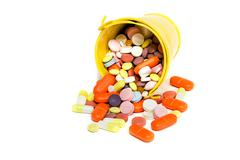 pills in a small bucket - stock photo