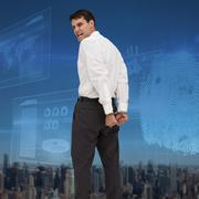 Composite image of rear view of young businessman wearing handcuffs Stock Photos