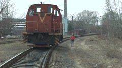 She goes near the abandoned train - stock footage