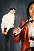 Composite image of businesswoman banging a law hammer on the gavel - stock photo