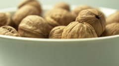Walnuts in the bowl - stock footage