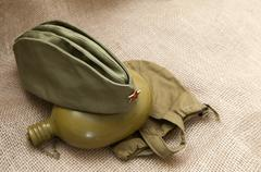 Army still life on the background fabric - stock photo