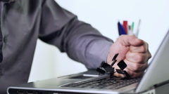 angry businessman smashing pc with a fist - stock footage