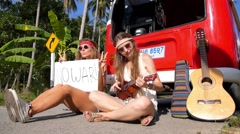 No War Appeal Sign of Hippy Pacifism Girls on Road. Slow Motion - stock footage