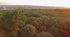 Aerial Fly out of the park and cityscape Belgrade, Serbia in background - stock footage
