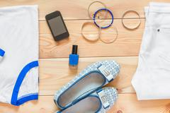 women's clothing and matching accessories on wooden boards - stock photo