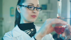 Woman working in a laboratory Stock Footage