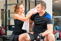 Loving couple in the gym resting after sport activities Stock Photos