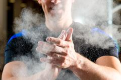 Male hands smeared talcum powder close up Stock Photos