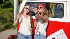 Boho Hippy Girls Taking Selfie with Smart Phone near Minibus - stock footage