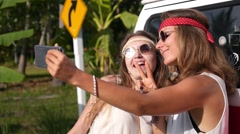 Hipster Hippie Girls Taking Selfie with Minivan with Phone Stock Footage
