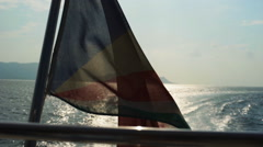 Seychelles flag waving on the boat - stock footage