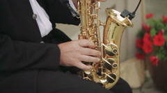 Side Shot of Male Playing Saxophone in the Street - stock footage