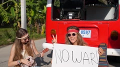 Hippie Girls with No War Message and Peace Symbol Concept Stock Footage